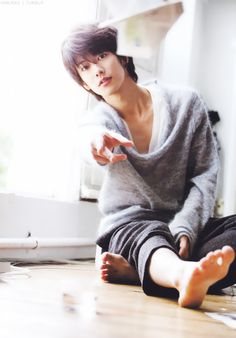 Japanese actor Sato Takeru. Nice informal shot sending the paper airplane flying! -Lily