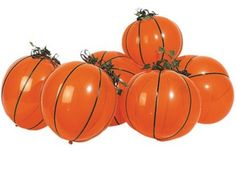 pumpkin balloons-green string, ivy leaves, and orange balloons with some weights in them. Easy peasy centerpiece
