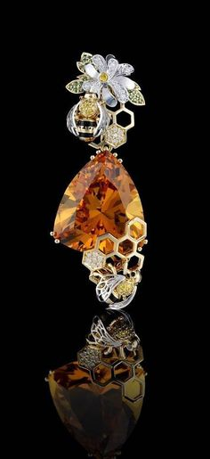 bee-hive honeycomb brooch with bees, flower around centered citrine stone setting.