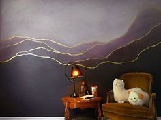 Gold leaf dividing wall paint plums and aubergines.