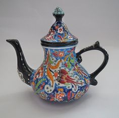 A beautiful handmade Turkish Ceramic Teapot serves as a charming table decor. This item is handmade to order and may differ slightly from the image shown. For decorative use only. - 100% lead free - S