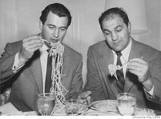 1958 - Rock Hudson and boxer Rocky Marciano eat spaghetti at the Fairmont Hotel in January 1958 Photo: Bill Young / SF