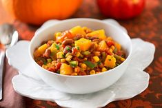 """<p>Here's a great main dish option for Thanksgiving dinner. It's somewhat like chili, though more about the squash than beans. In Native American mythology, squash, corn, and beans are known as the """"three sisters"""" — the very crops that the harvest festival of Thanksgiving is meant to celebrate! If you bake your pumpkin or squash a day ahead, the stew will come together in a snap. And if you're not accustomed to dealing with winter squash, or don't have the time, see the shortcut following…"""