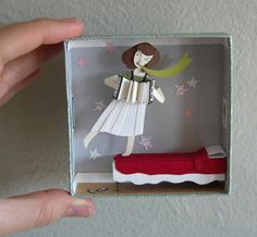 Paper Art 3D.  Girl on Bed. Like when Maggie plays her accordion.