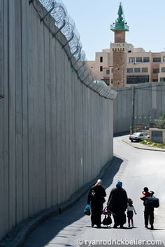 ABU DIS, PALESTINIAN TERRITORIES -Palestinian women and children walk in the shadow of the Israeli separation barrier dividing the East Jerusalem Palestinian neighborhood of Abu Dis. Oh The Places You'll Go, Places Ive Been, Where Is The Love, East Jerusalem, Heaven's Gate, Israel Palestine, Visit Egypt, April 11, Holy Land