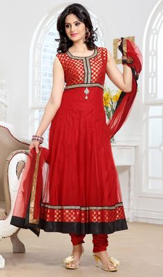 Trendsetter Red Net Anarkali Suit You look so charming wearing this trendsetter red net Anarkali suit. This ravishing attire is amazingly embroidered with stones work. Brocade might vary from actual image.  #AnarkaliSuitCollection #BollywoodAnarkaliSuits