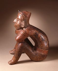 Seated male figure in gorgeous red burnished ceramic with slip from Colima, Mexico, 200 B.C. - A.D. 500