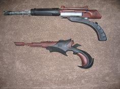 Two Klingon disruptors built for STAR TREK: THE MOTION PICTURE.  The top one  (the 'Deathsting')  was seen in the crew's holsters, and was used in some early NEXT GENERATION episodes, slightly altered. Although the bottom one was not used, it did become the weapon of choice for the action figures.
