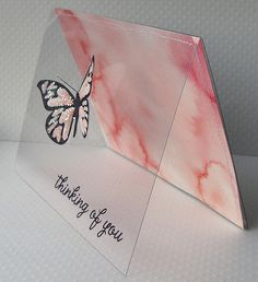 handmade greeting card ... clear acetate front with glittery butterfly and the sentiment stamped on ... luv the look of the butterfly ... dreamy pink watercolor background shows through ... looks like the acetate also goes to the back .... great card!!