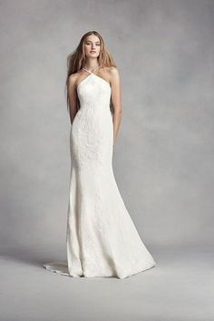 White by Vera Wang's sheath wedding dress features hand-beaded lace appliques and an on-trend halter neckline. Exclusively at David's Bridal.