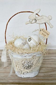 Romantic Country Easter Display/Gift: Paint an old pail (or rough up a new one from the dollar store), line the inside with floral foam & raffia, embellish the outside with lace, ribbons, & a little sparkle. Wrap the handle with some lace or organza ribbon & add in your choice of easter items.