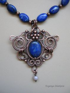 Appelsinium - Lapis Lasuli and Sunstone Necklace via Etsy./ Even just the blue lapis and the silver beaded necklace.