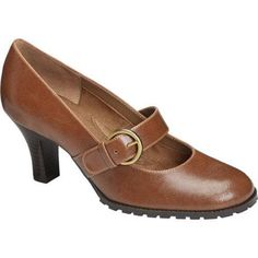 """The Missle is a darling mary jane pump revamped in a fresh and modern style. All eyes will be on the wide strap with side buckle entry that complements everything. The flexible bottom with diamond pattern and a 2¾"""" stacked heel complete"""