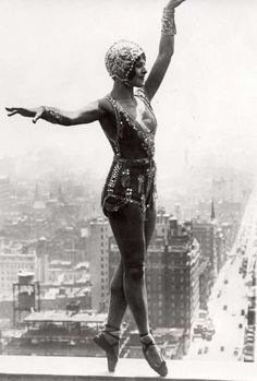 The dancer Lina Basquet with much glitter in her hot outfit, balancing on high altitude, 1926