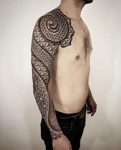 Brandon Crone combines multiple tattoo styles to produce cohesive, stunning pieces of body art. Fusing dotwork, blackwork, and geometry, he adorns clients'