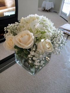 cream roses with white hydrangea and baby's breath in a square vase