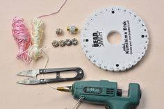 Supplies needed in the pink nylon thread kumihimo bracelet with European rhinestone beads: