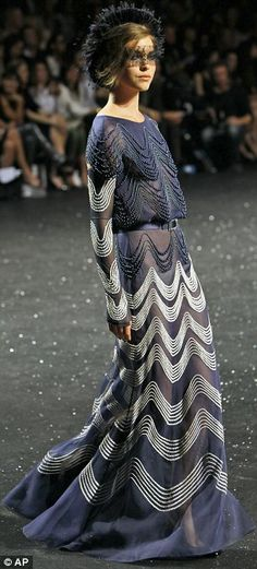 Intricate detail: The lightest of dusty grey-blue silks were heavy with silver and pearl embellishment. Chanel Couture.    Read more: http://www.dailymail.co.uk/femail/article-2011627/Diane-Kruger-Alexa-Chung-applaud-Karl-Lagerfeld-Chanel-Paris-couture-show.html#ixzz1uiRa5xdU
