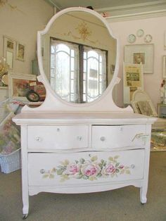 Stunning dresser in white with painted roses.