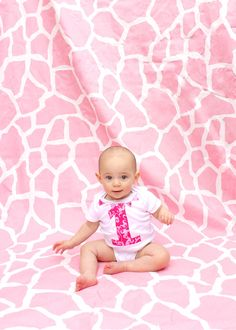 A very pink giraffe-print inspired birthday party for my daughter's first birthday! Shades of pink, giraffe prints, tulips and pennant banner flags made her first birthday party exactly what I envisioned.