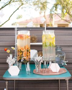 During cocktail hour around the pool, partygoers helped themselves to spiked beverages—a fizzy and fruity vodka punch and a citrusy riff on gin and tonic—from glass dispensers.