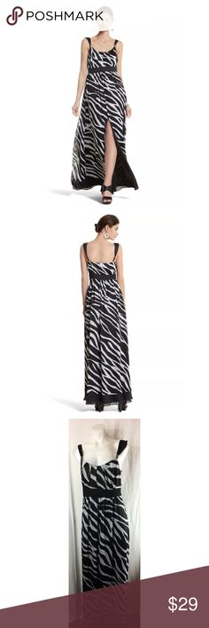 White House Black Market dress maxi zebra print White House Black Market dress maxi sleeveless slit lined zebra print zips on the side Women's Size:  8 Approx measurement: armpit to armpit - 17 1/2 inches; length (armpit to hem) - 49 inches;  Fabric content: 100% polyester, lining: 100% polyester dry clean Gently used - see pictures White House Black Market Dresses Maxi