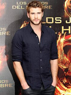 Liam Hemsworth gets to work, spreading the word about his upcoming flick, The Hunger Games (out March 23)