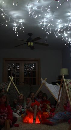 indoor camping under the stars - Beth Kruse Custom Creations. This fake fire is such a cute indoor party idea. She used red and orange tissue paper, and logs, and red rope lights from Hobby Lobby Yup when the kids all come stay with aunt Mary! Winter Birthday Parties, Birthday Fun, Birthday Ideas, Sleepover Party, Slumber Parties, Girl Parties, Party Fun, Ideas Party, Indoor Camping