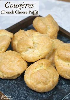 Gougères, or French Cheese Puffs, are light and airy, cheese-filled pastry bites with a crisp outside and a soft, buttery inside. Once you make them, you'll want to serve this recipe as an appetizer at every party! | www.CuriousCuisiniere.com