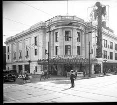 Northeast corner of 5th Street and Walnut Street, now Muhammad Ali Boulevard. B.F. Keith's Theater at the corner. It is a rounded white building with a sign mounted to the front of the building, 1928. :: Metropolitan Sewer District Collection