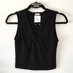 "BNWT black ribbed lace up tank 17"" in length  The strap has 2"" fraying but doesn't affect whole looking Brandy Melville Tops Tank Tops"