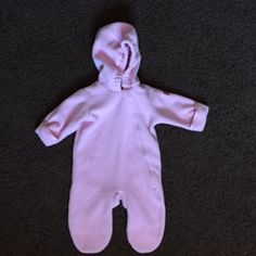 "A very comfy cozy pink snowsuit for your infant girl, with a zipper closure and cuffs on the sleeves to keep hands nice and warm. It is by Wigeon and measures: armpit-armpit 14""; shoulder-toe 25.5""; armpit-sleeve hem 8""; inseam 10"". 