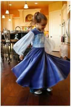 Girl spinning in blue Appleblossom dress