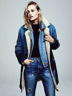 Sherpa Bonded Denim Coat   This long denim coat features contrast patch detailing.  Super cozy with a Sherpa collar and lining.  Hip pockets with a single button closure.