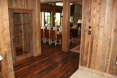 Looking into main living area from the entry way. Six-light door into the media room by Reclaimed Lumber Products.