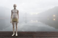 Italian artist Bruno Walpoth has carved these impressive human figures out of blocks of wood. Walpoth coats each sculpture, oftentimes a human figure who appears to be in deep thought, with semi-translucent paint in order to bring out the grains in the wood.