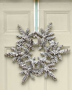 Long, slender pinecones, such as those of a white pine, work best for this new take on a Southern holiday classic—the pinecone wreath. Finish with a narrow ribbon layered on top of a wider ribbon. Learn how to make this snowy pinecone wreath Pine Cone Art, Pine Cone Crafts, Christmas Projects, Pine Cones, Holiday Crafts, Holiday Decor, Christmas Ideas, Thanksgiving Holiday, Family Holiday