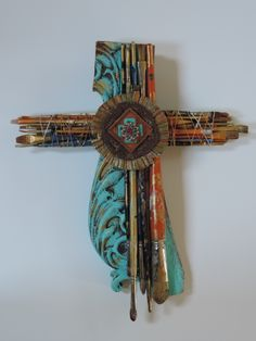 Cross made from paintbrushes and furniture parts-
