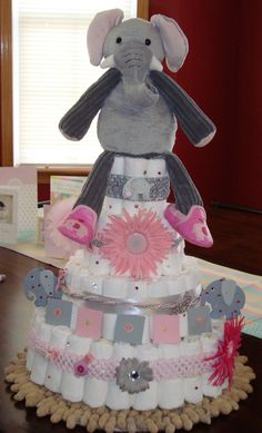 Diaper Cake! Decorations include a Scentsy Buddy on top!  Great idea!  New Safari animals coming in September 2013