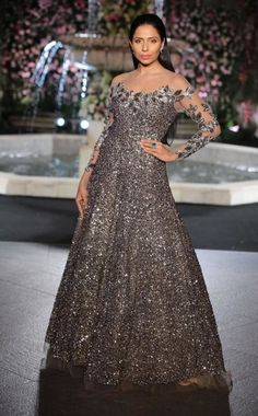 Cocktail Outfits - Sequinned Dark Grey Gown | WedMeGood | Dark Grey All Over Sequinned Gown with Sheer Sleeves and Cut Work on Neck #wedmegood #gown #cocktail #grey #sequinned #sheer #indianbride #indianwedding