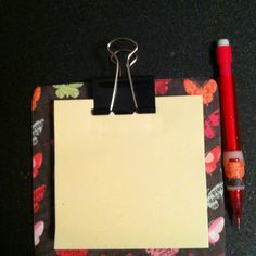 coasters, scrapbook paper, clip, pad and little pen/pencil.  paper on coaster and clip in place with clip.  pen/pencil is kept in place with a little piece of paper that is glued between coaster and scrapbook paper.  Neat, cheap gift/idea