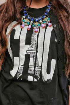 chic graphic tee with a statement necklace
