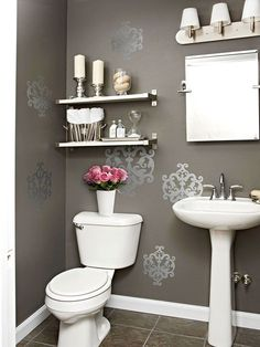 Shimmer & Shine     Put a little zing in your powder room with wall decals. Easy to apply and affordable, these pockets of pattern give this bathroom just the right amount of shimmer
