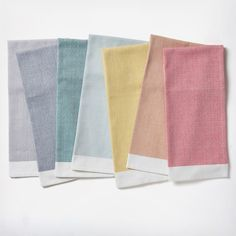Fun colored napkins like these Coyuchi Diamond Chambray 7-Piece Kitchen Towel Set are a fun touch for the warmer seasons. Discover more spring gifts for your registry at Zola.