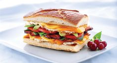This tour de force features Wisconsin Edam and Cheddar, an over-easy egg, and strips of crispy bacon.
