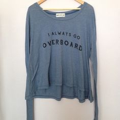 """Wildfox """"I Always Go Overboard"""" Jumper Blue Wildfox pullover. In excellent condition! Size tag is gone and I don't know what size it is (selling for my sister and she doesn't remember.) From the fit on me I think it's a small or medium in Wildfox sizes. For reference I am almost 5'5 and wear a 34DD and I usually wear an XS in Wildfox. Wildfox Tops Tees - Long Sleeve"""