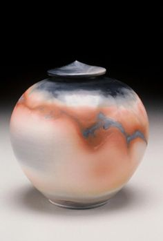 Jan Lee's naked raku and saggar-fired works balance a soft elegance of form with the intense crackling electricity of daring smoke patterns. These meticulously smooth vessels serve as a quiet frame for bold swaths of lightning, fracture, and inferno