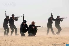 IRAQ, Karbala : Members of the popular mobilisation unit attend a combat training session at a military camp in the Iraqi Shiite shrine city of  Karbala in central Iraq on March 12, 2015, ahead of joining the  military operation in the city of Tikrit. AFP PHOTO / MOHAMMED SAWAF
