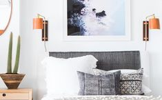 """I lurve dees sconces from @shoppe_by_ai ... Gettem while they HAWT. #shoppeisdope Also I love a good crispy white sheet. We now stock Matteo bedding in…"""