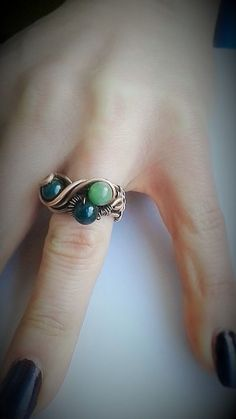 Copper ringHandmade copper ring with green stones  by Tangledworld